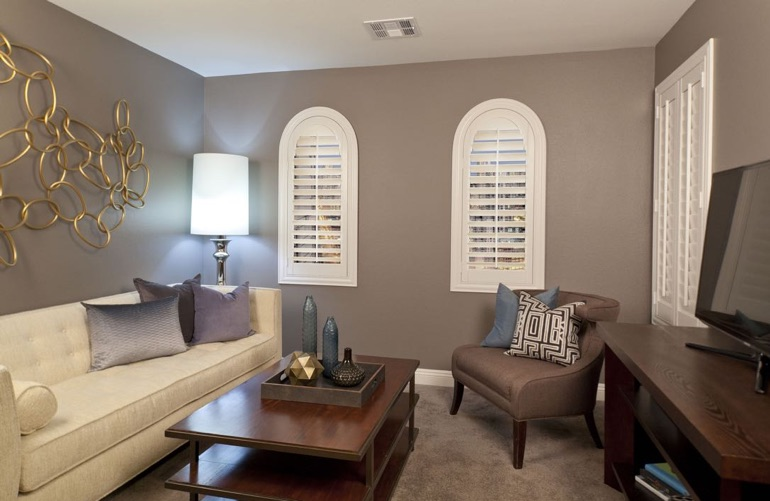 Dallas family room with rounded plantation shutters.