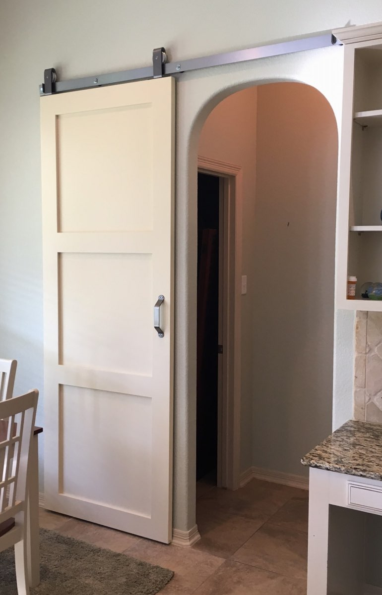 Contemporary style barn door in Dallas kitchen.
