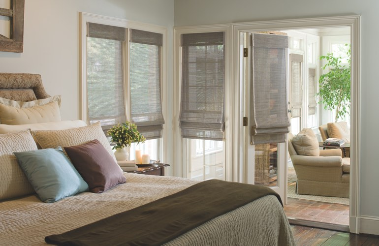 Bedroom with woven shades on windows