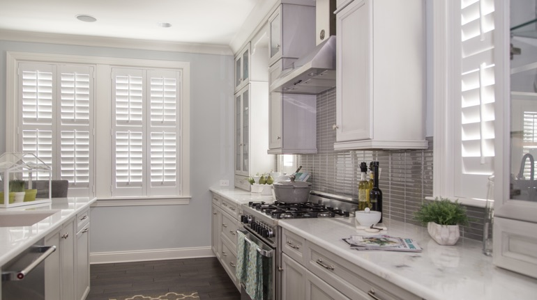 White shutters in Dallas kitchen with modern appliances.