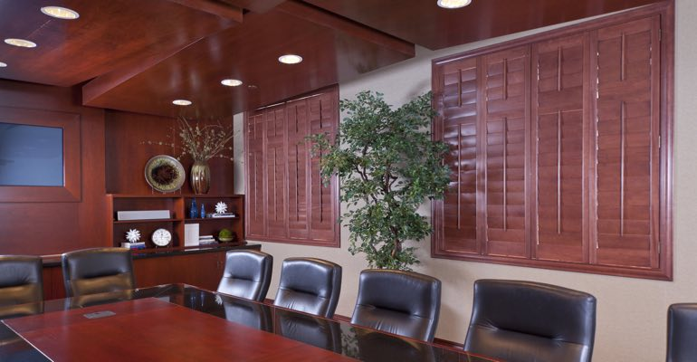 Shutters are one option for covering a conference room's windows
