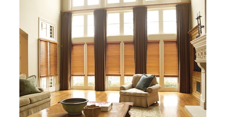Dallas great room with wooden blinds and full-length drapes.