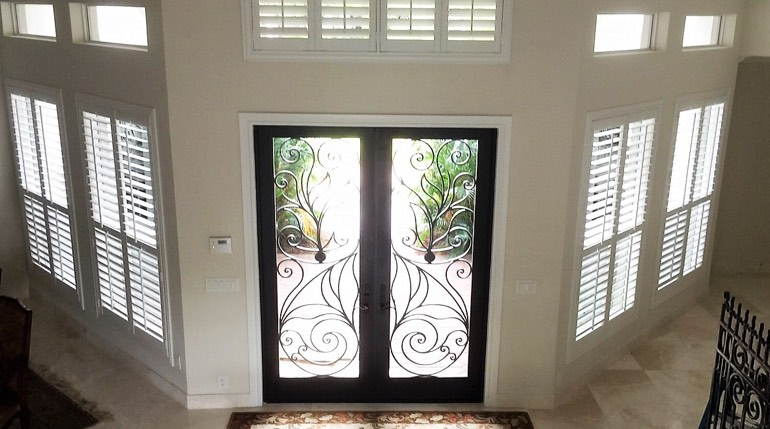 Dallas entryway white shutters