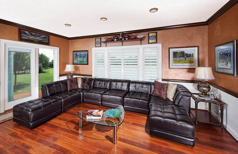 Dallas basement with sliding doors and plantation shutters.