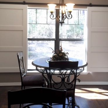 Dallas dining room barn door shutters.