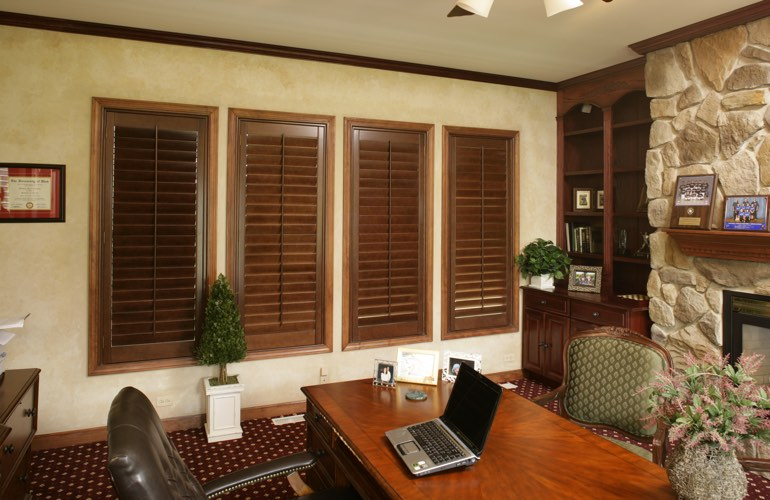 Wooden plantation shutters in a Dallas home office