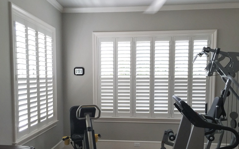 Dallas exercise room with shuttered windows.