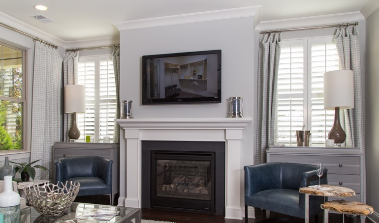 Dallas fireplace with plantation shutters.