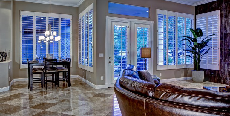 Dallas great room with plantation shutters and modern lighting.