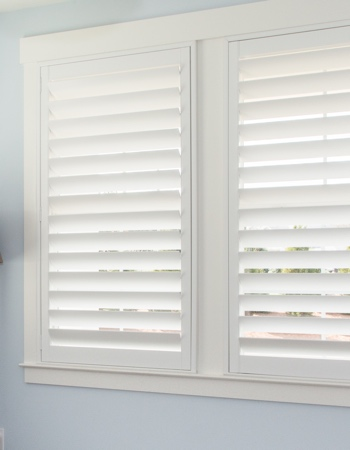 White plantation shutters with hidden tilt rods in Dallas