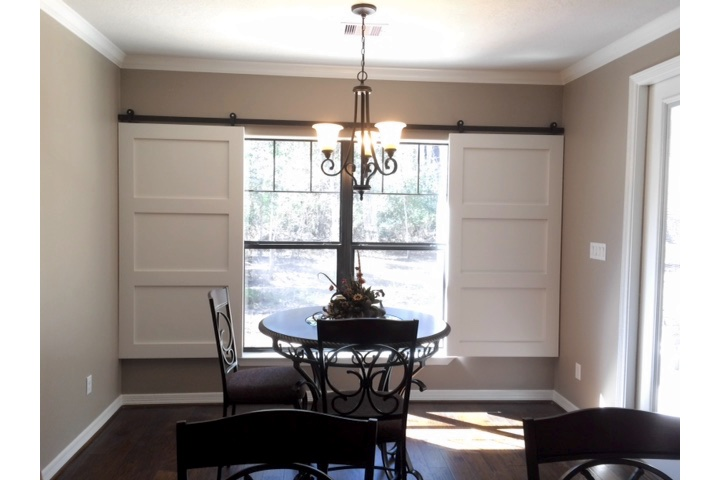 Dallas dining room with moveable barn door shutters.