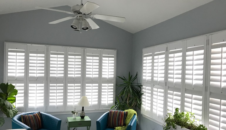 Dallas sunroom with fan and shutters