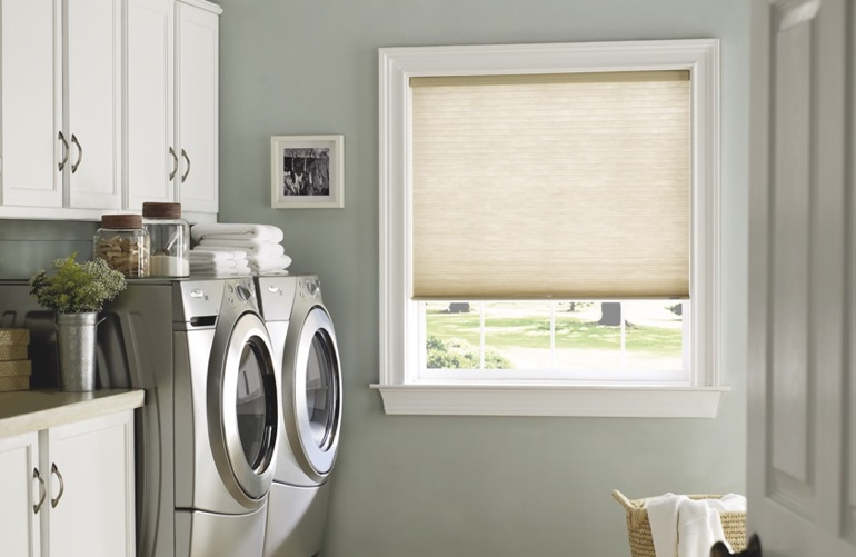 Dallas laundry room with beige window shades.