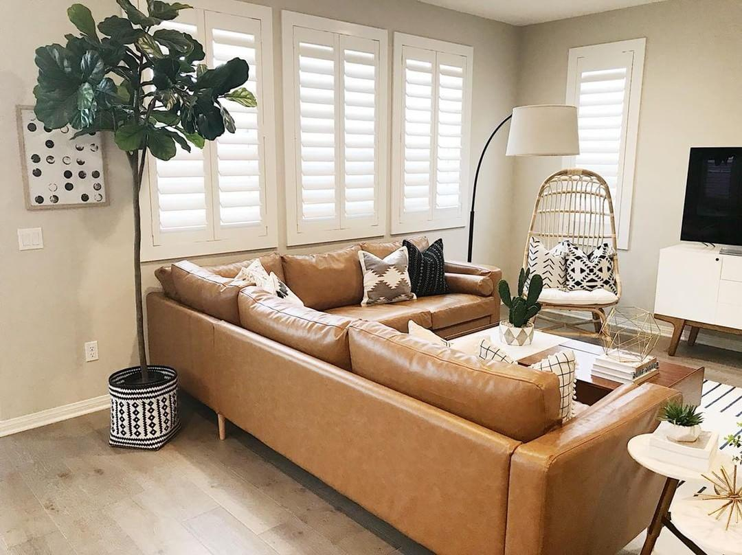 Warm living room with our Polywood shutters in Dallas.