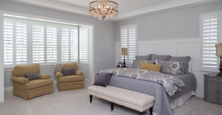 White shutters in Dallas bedroom.