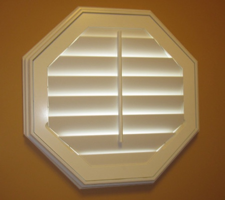 Dallas octagon window with white shutter