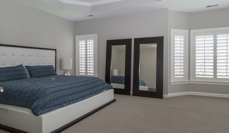 Polywood shutters in a minimalist bedroom in Dallas.
