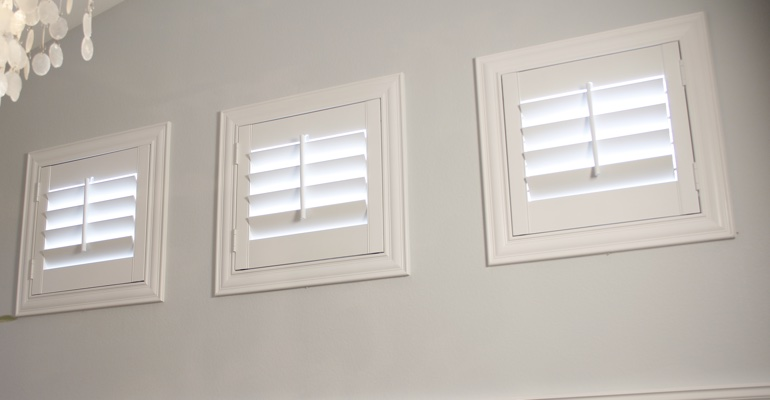 Shutters on square windows in laundry room