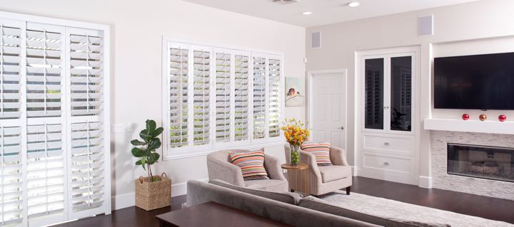 Dallas living room in white with plantation shutters.