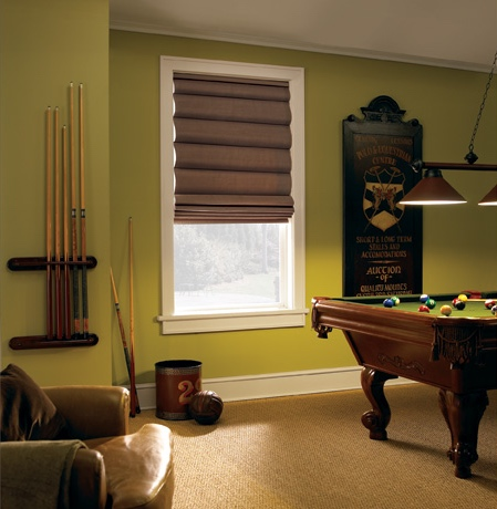 Roman shades in Dallas pool room with green walls.