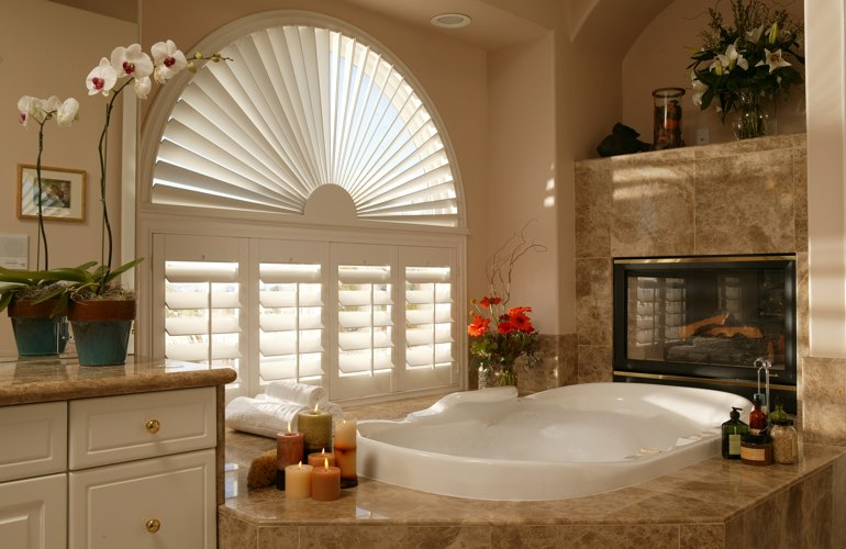 Semicircle shutters in a Dallas bathroom.