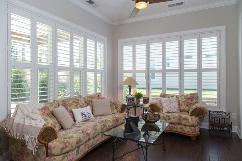 Traditional sunroom with plantation shutters in Dallas.