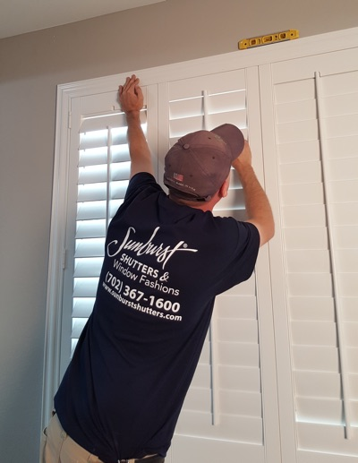 Shutter installation in Dallas bedroom.