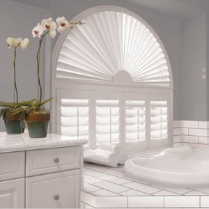 White plantation shutters in bathroom