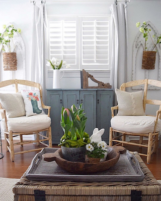 White shutters in breezy sunroom.