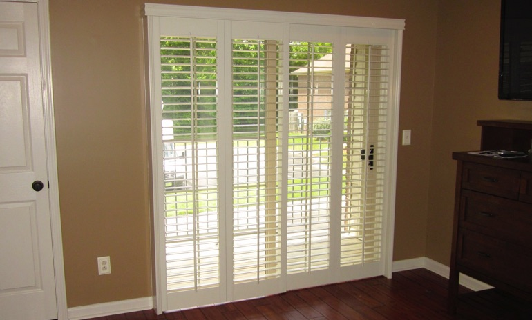 Dallas sliding door bifold shutters in patio
