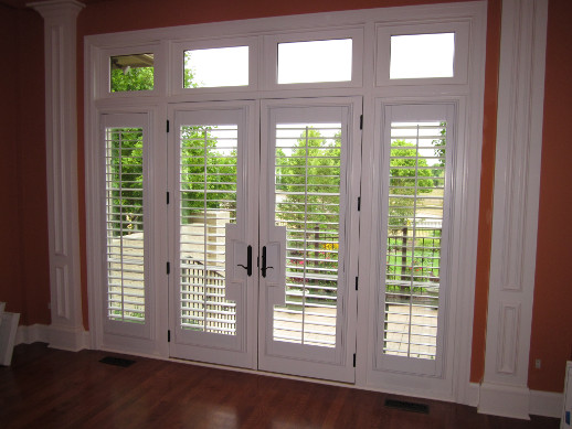 Dallas patio door with sidelight shutters
