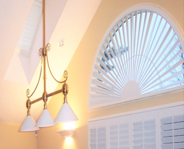 Dallas arched eyebrow window with classic shutter