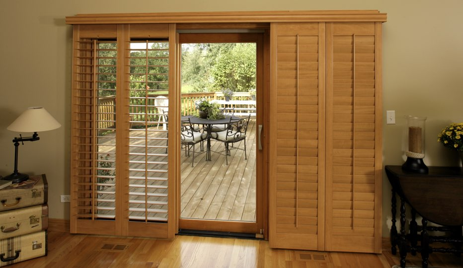 Bypass wood patio door shutters in Dallas living room