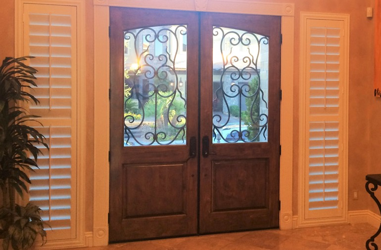 Sidelight window shutters in Dallas entryway