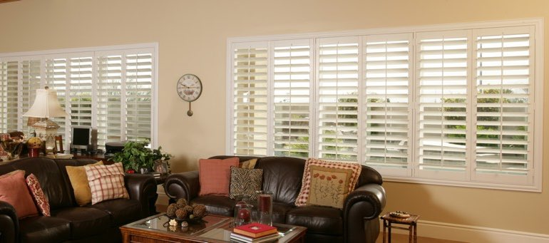 Wide window with interior shutters in Dallas living room